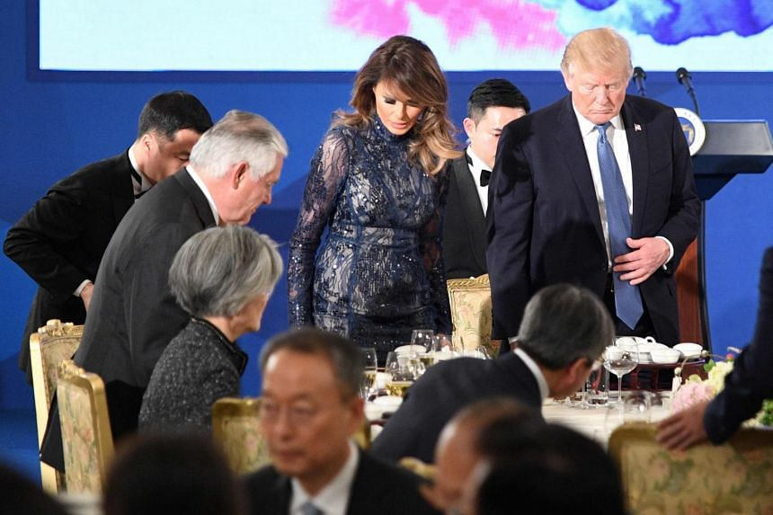 U.S. President Donald Trump (centre R) and First Lady Melania Trump (centre L) arrive for a state dinner with South Korea's President Moon Jae-In at the presidential Blue House in Seoul on November 7, 2017.