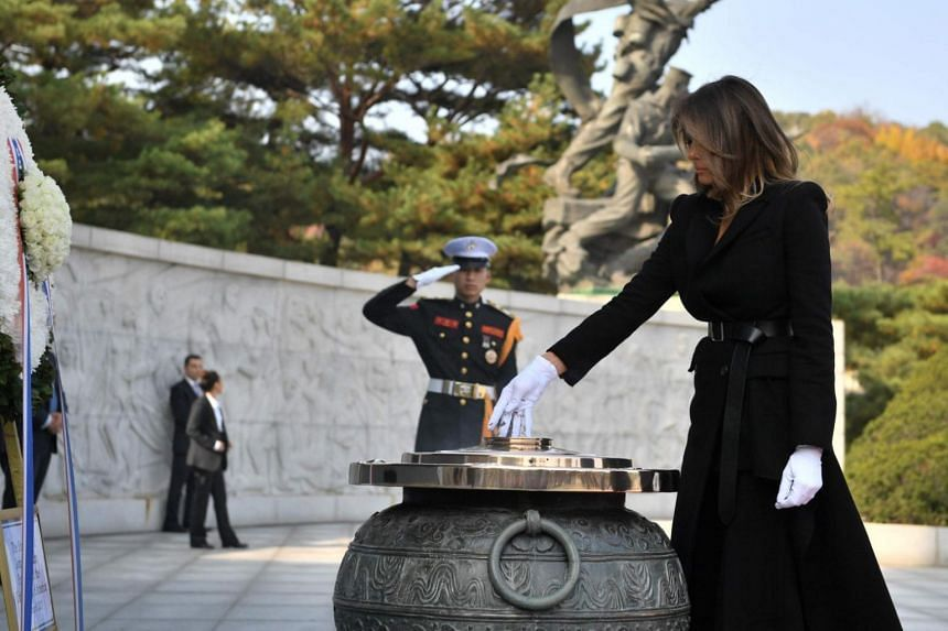 US First Lady Melania burns incense at the National Cemetery in Seoul, South Korea, on Nov 8, 2017.