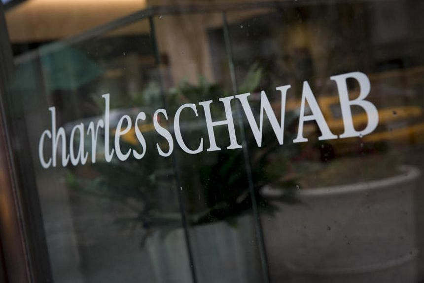 The Charles Schwab Corp logo is displayed at an office in New York.