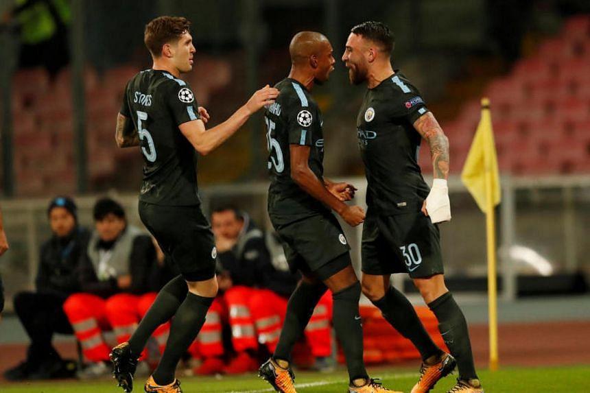 (From right) Manchester City's Nicolas Otamendi celebrates scoring their first goal with Fernandinho and John Stones on Nov 1, 2017.