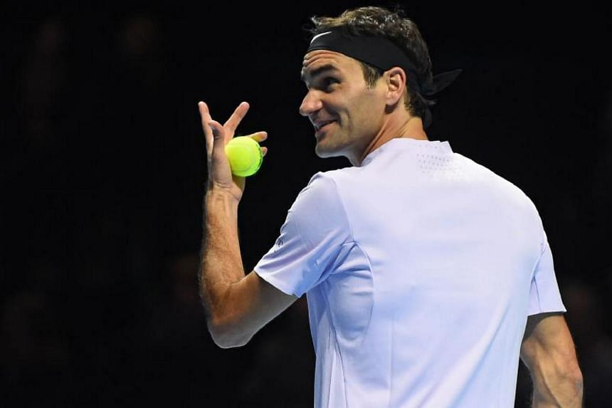 Switzerland's Roger Federer gestures to Britain's Andy Murray in their exhibition tennis singles match, during Andy Murray Live at the SSE Hydro in Glasgow, Scotland on Nov 7, 2017.