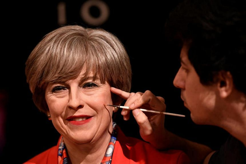 The wax figure of Theresa May, stepping out of Number 10 Downing Street in a red power suit and leopardskin kitten-heeled shoes, was unveiled by Madame Tussauds on Nov 8, 2017.