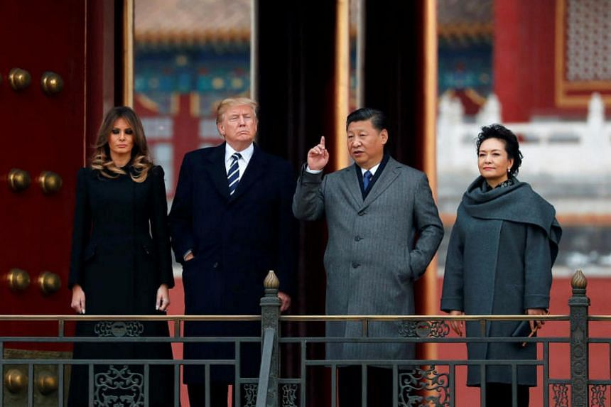 US President Donald Trump and US first lady Melania visit the Forbidden City with China's President Xi Jinping and China's First Lady Peng Liyuan in Beijing on Nov 8, 2017.