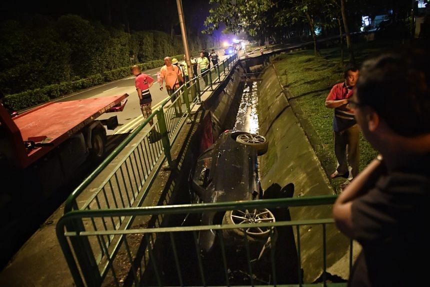 A car ended up in a drain near Balmoral Plaza along Bukit Timah Road, after an accident on Nov 7, 2017.