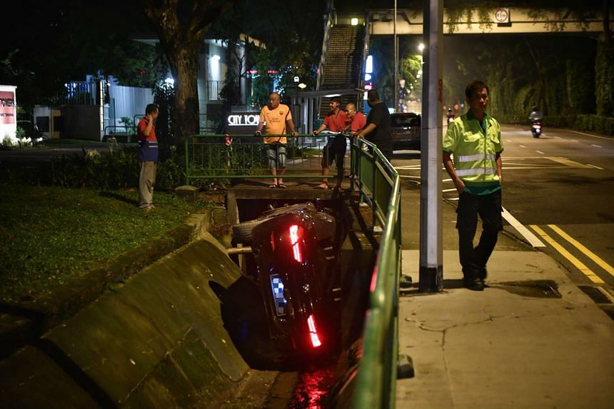 The car crashed into the drain after an accident involving a pedestrian, said police.