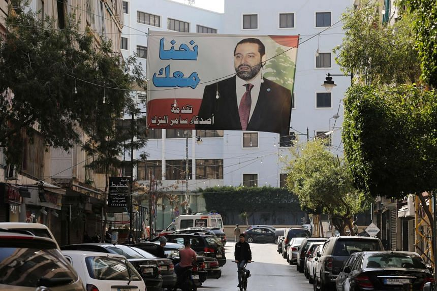 A banner bearing the portrait of former PM Saad al-Hariri hangs in Beirut a day after his resignation, on Nov 5, 2017.