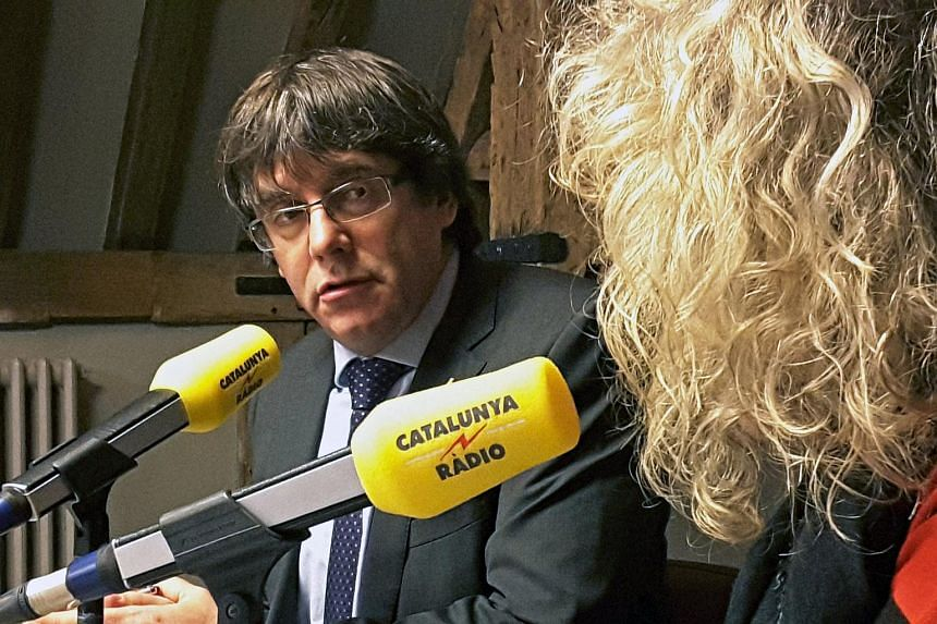Deposed Catalonian leader Carles Puigdemont giving a radio interview in Brussels on Nov 7, 2017.