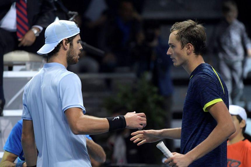 Daniil Medvedev (right) shaking hands with Karen Khachanov after winning their Group B men's singles tennis match at the Next Generation ATP Finals in Milan on Nov 7, 2017.
