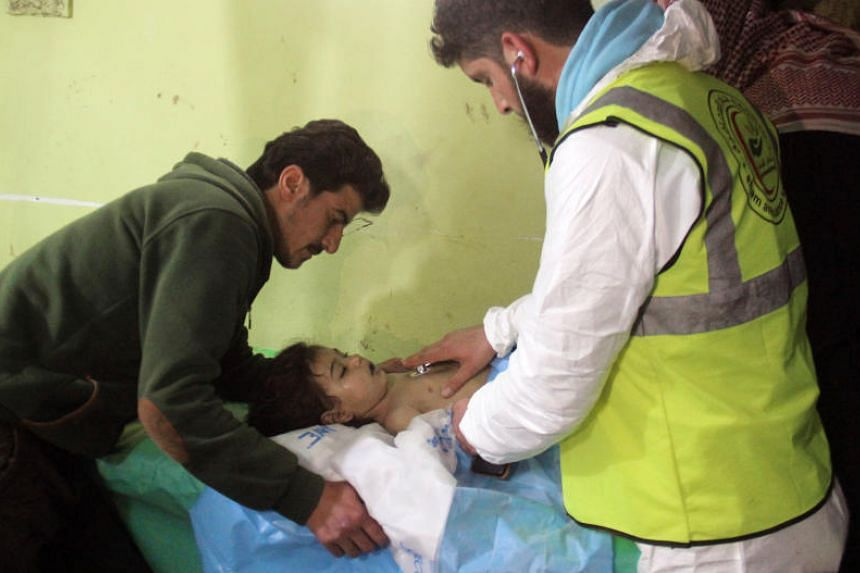 An unconscious Syrian child receiving treatment at a hospital in Khan Sheikhun, a rebel-held town in the northwestern Syrian Idlib province, following a suspected toxic gas attack on April 4, 2017.