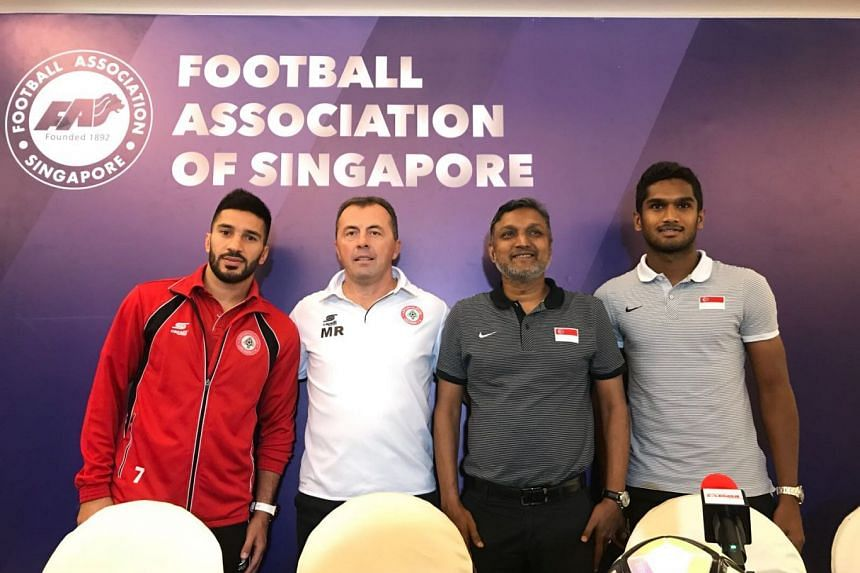 (From left) Lebanon captain Hassan Maatouk, head coach Miodrag Radulovic, Singapore coach V. Sundram Moorthy and vice-captain Hariss Harun pose for a photo during the press conference.