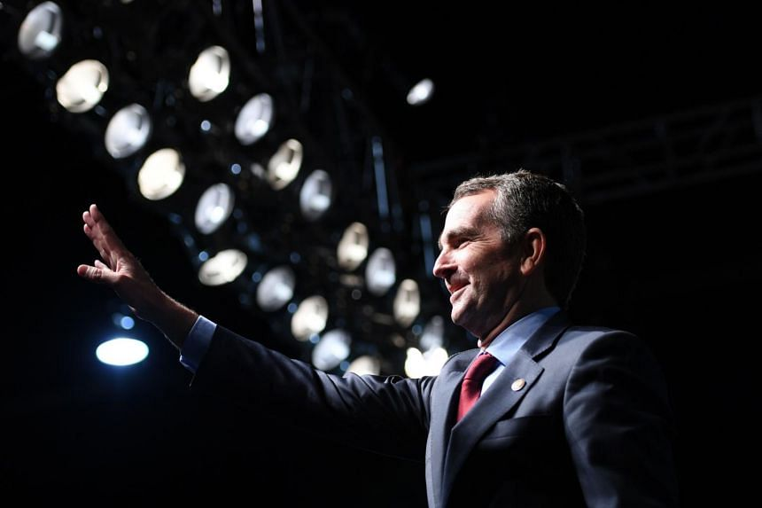 Democrat Ralph Northam waving as he arrives to speak during a campaign rally in Richmond, Virginia.
