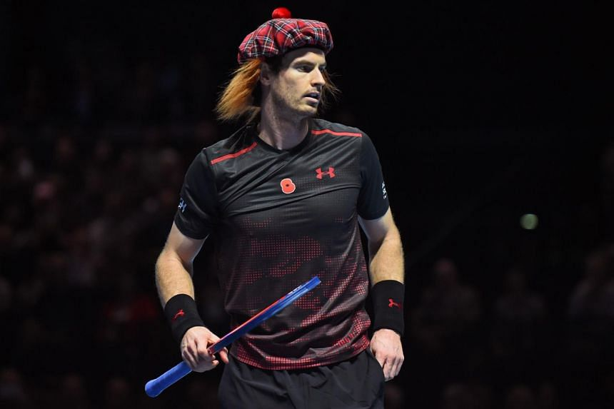 Andy Murray wears a tartan hat as he plays Roger Federer in their exhibition tennis singles match, during Andy Murray Live.