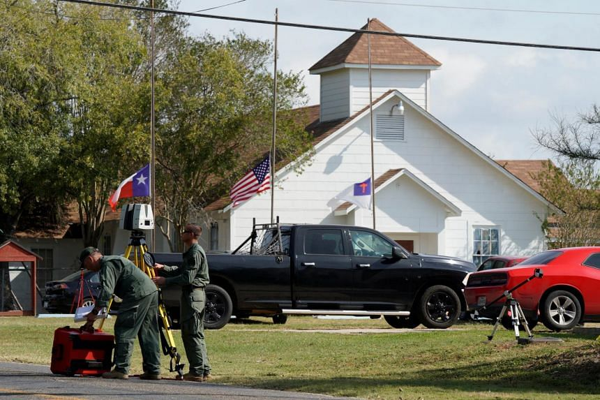 Officials with a scanner near the entrance of the site of the shooting at the First Baptist Church of Sutherland Springs, Texas.