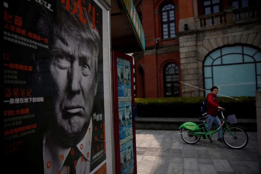 A Chinese magazine poster showing US President Trump is displayed at a newsstand in Shanghai, China.