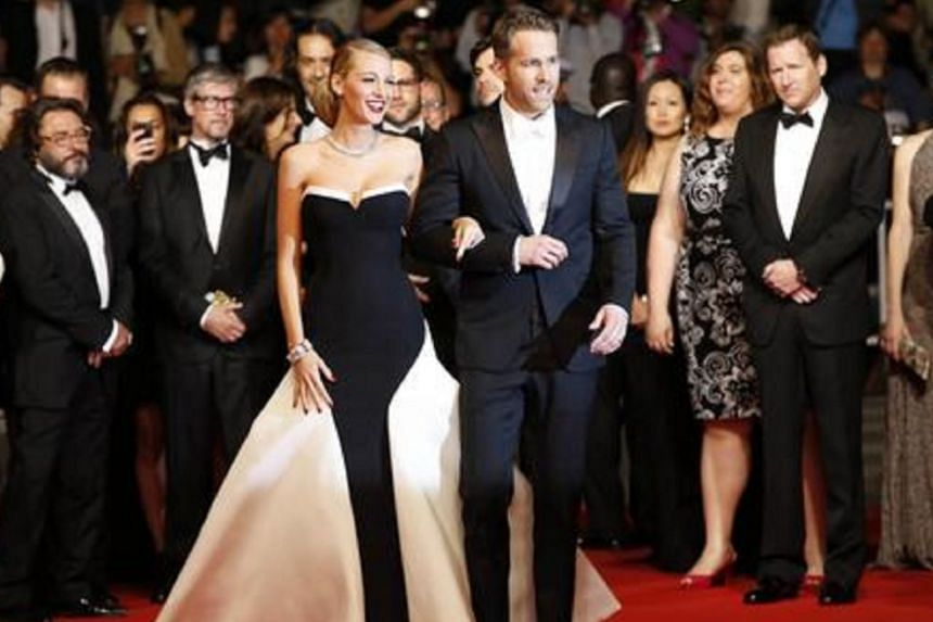 White tie: Blake Lively, with her husband, actor Ryan Reynolds, at the 2014 Cannes Film Festival.