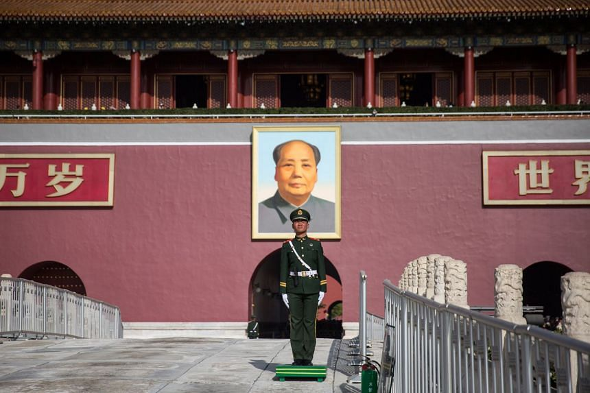 A member of China's People's Liberation Army stands guard in front of the Chairman Mao portrait on the south gate of the Forbidden City, next to the Tiananmen Square, in Beijing, on Nov 7, 2017. US President Donald Trump will visit China from Nov 8-1