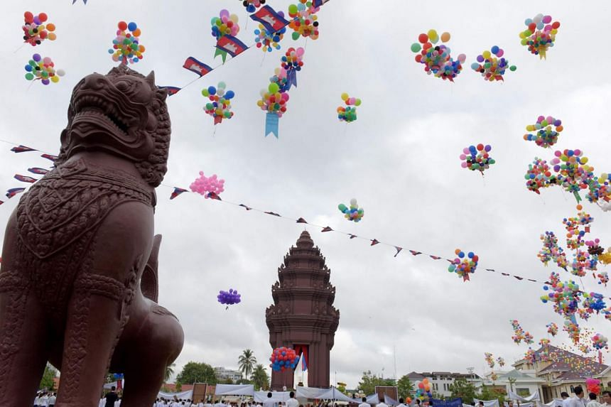 Balloons fly near Independence Monument during a ceremony marking Cambodia's Independence Day in Phnom Penh on Nov 9, 2017.
