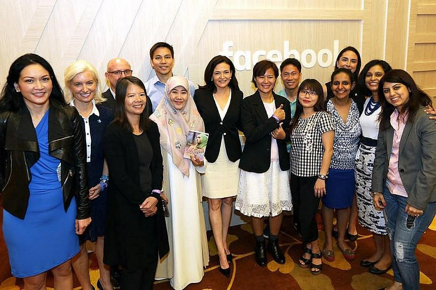 Facebook chief operating officer Sheryl Sandberg (middle) with staff and community leaders from Singapore and the region at the first Asia-Pacific Facebook Community event at Marina Bay Sands yesterday.