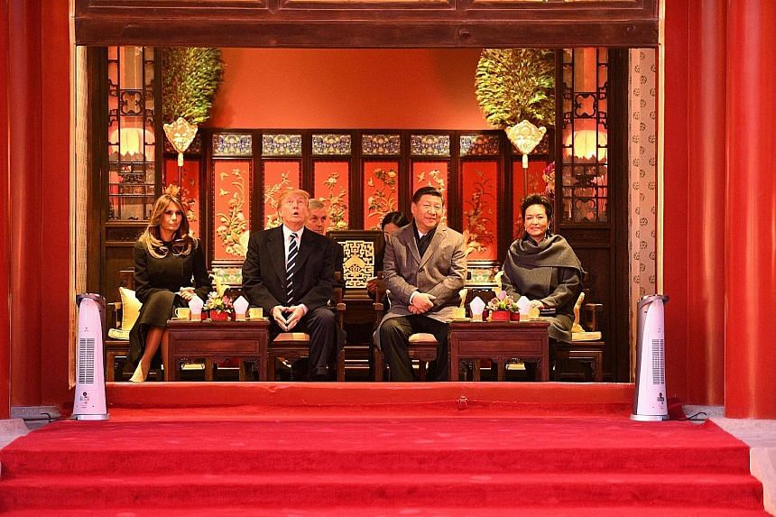 US President Donald Trump and Chinese President Xi Jinping with US First Lady Melania Trump and Mr Xi's wife Peng Liyuan during a tour of the Forbidden City in Beijing yesterday.