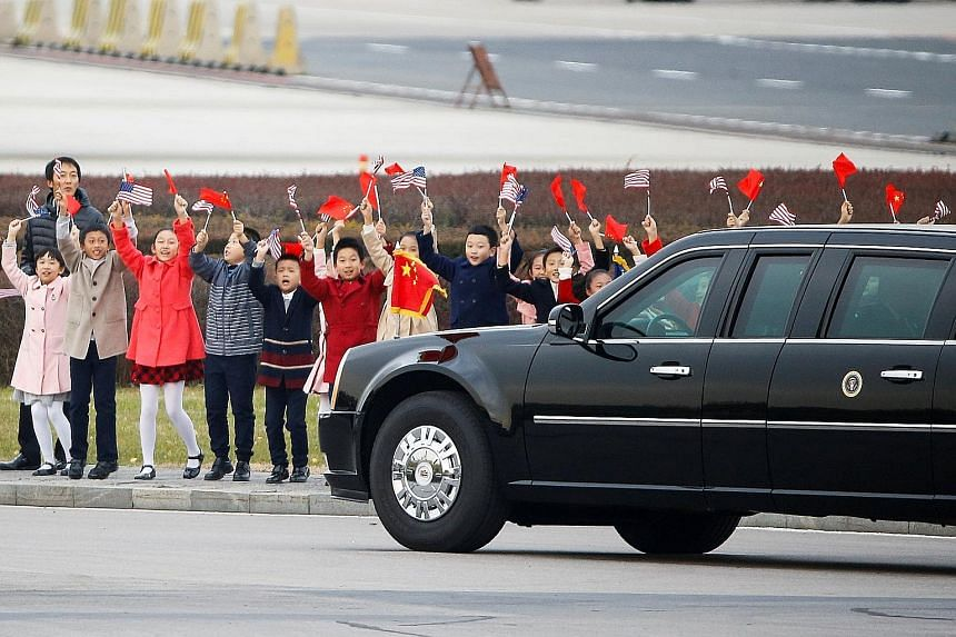 Mr Trump meeting opera performers at Beijing's Forbidden City. Analysts said his speech in Seoul was firm yet measured, as he sought to assuage South Korean concerns of a looming war if the US were to pursue unilateral military action.