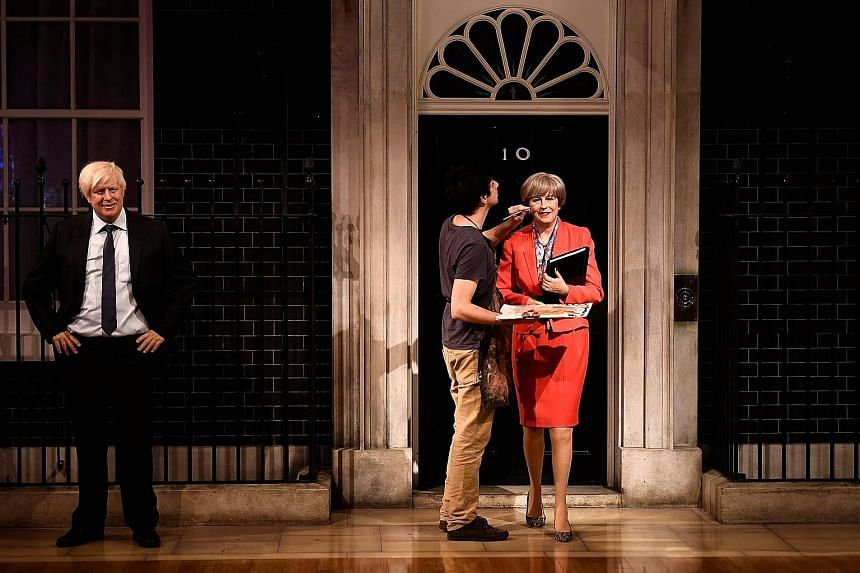 A wax figure of British Prime Minister Theresa May, stepping out of No. 10, Downing Street, in a red power suit and leopard-skin kitten-heeled shoes, was unveiled by wax museum Madame Tussauds yesterday. Also unveiled was the wax likeness of British