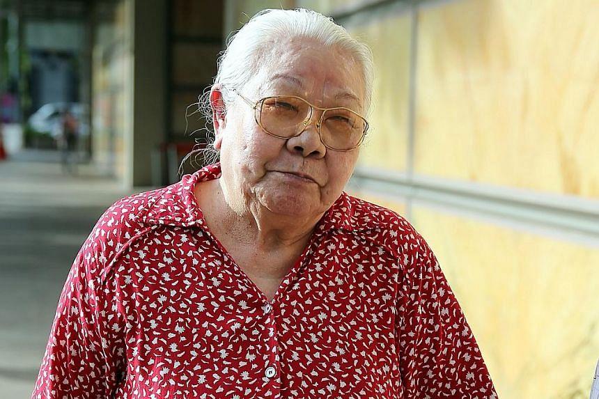 Madam Lim Hoon Neo (above).