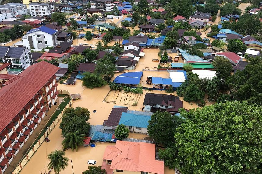 An aerial view of a flooded residential area in Georgetown, Penang, on Sunday. The floods over the weekend claimed seven lives and displaced more than 7,000 people.