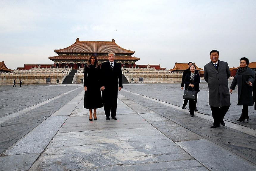 US President Donald Trump and his wife Melania posing for a photo at the Forbidden City yesterday. They were accompanied during the visit by Chinese President Xi Jinping and his wife Peng Liyuan (at far right).
