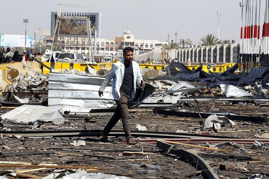 A Yemeni walking at the site of an alleged Saudi-led air strike on Sunday in Sana'a, Yemen, a day after Houthi rebels fired a ballistic missile at the Saudi capital, Riyadh. According to reports, the Saudi-led coalition launched several air strikes o