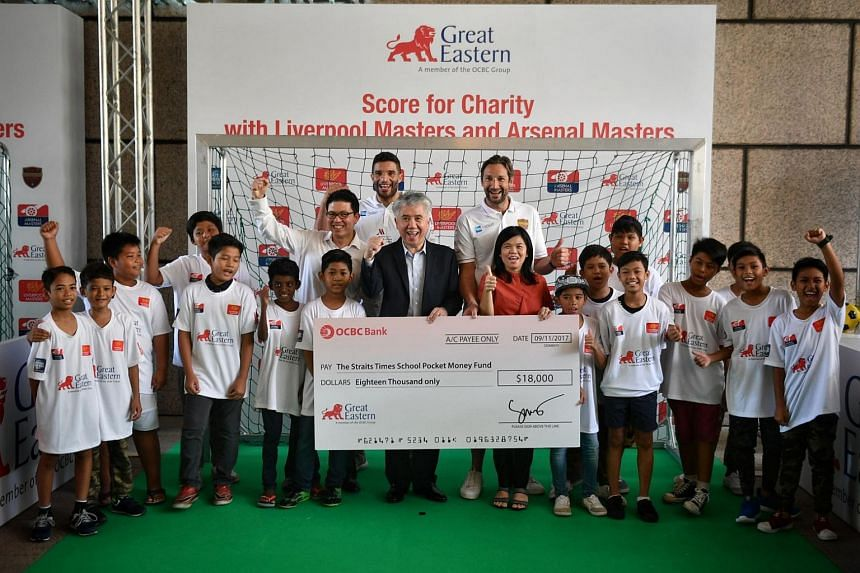 Great Eastern group CEO, Mr Khor Hock Seng presenting the cheque to Ms Tan Bee Heong, general manager of The Straits Times Pocket Money Fund at the event on Nov 9, 2017, along with kids from The Straits Times School Pocket Money fund and former EPL f