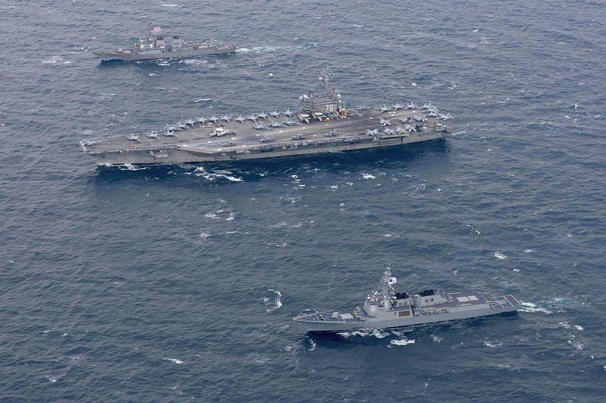 The USS Ronald Reagan (CVN 76) and the forward-deployed Arleigh Burke-class destroyer USS Stethem (DDG 63) steam alongside South Korean navy ships, during a bilateral training exercise.