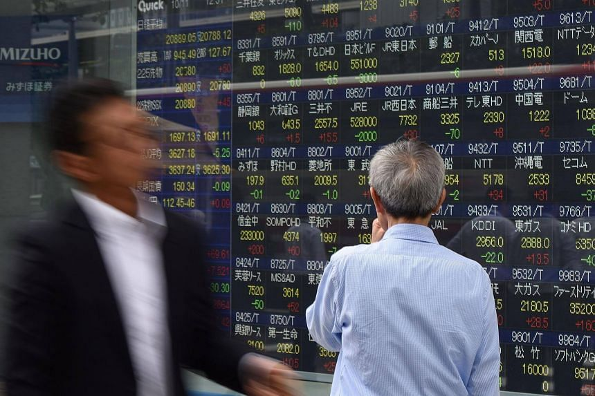 Asia stocks hovered near a decade high on Nov 9 following another record breaking day on Wall Street.