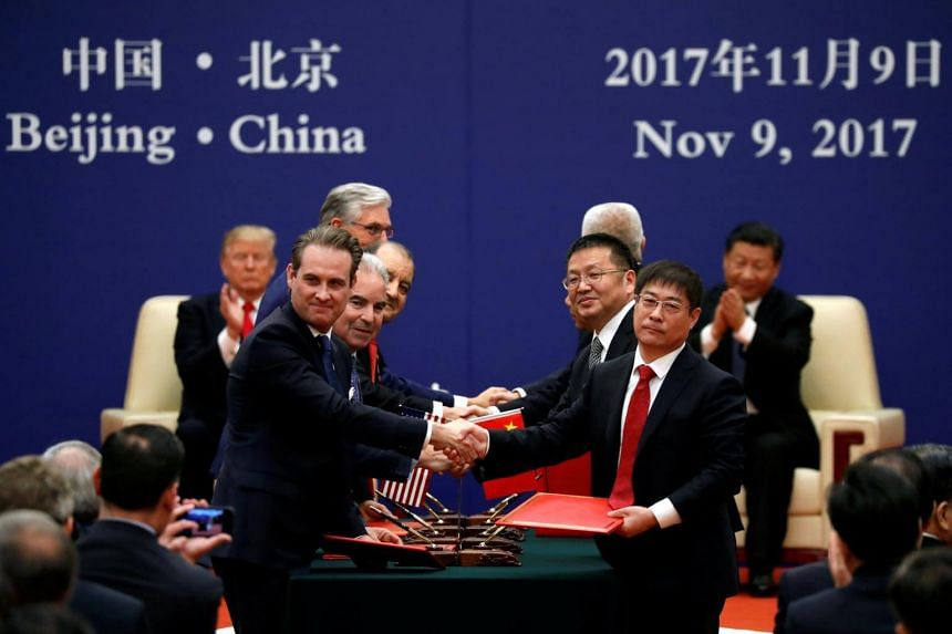 Mr Trump and Mr Xi witness the signing ceremony of a slew of energy, industrial and financial pacts.