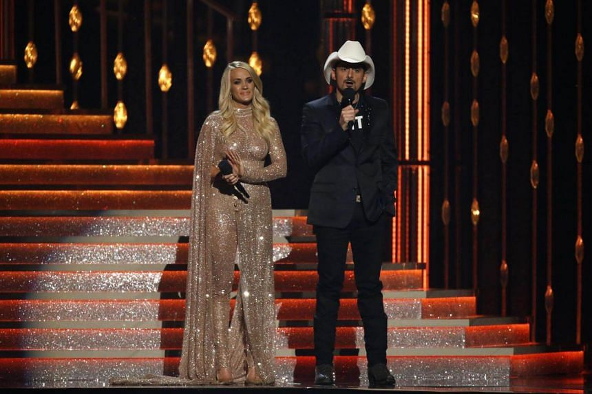 """Veteran hosts Brad Paisley (right) and Carrie Underwood took the reins, with the latter declaring: """"This has been a year marked by tragedy impacting countless lives, including so many in our country music family."""""""