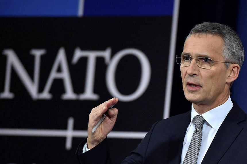 Nato Secretary-General Jens Stoltenberg gives a news conference during a NATO defence ministers meeting at the Alliance headquarters in Brussels.