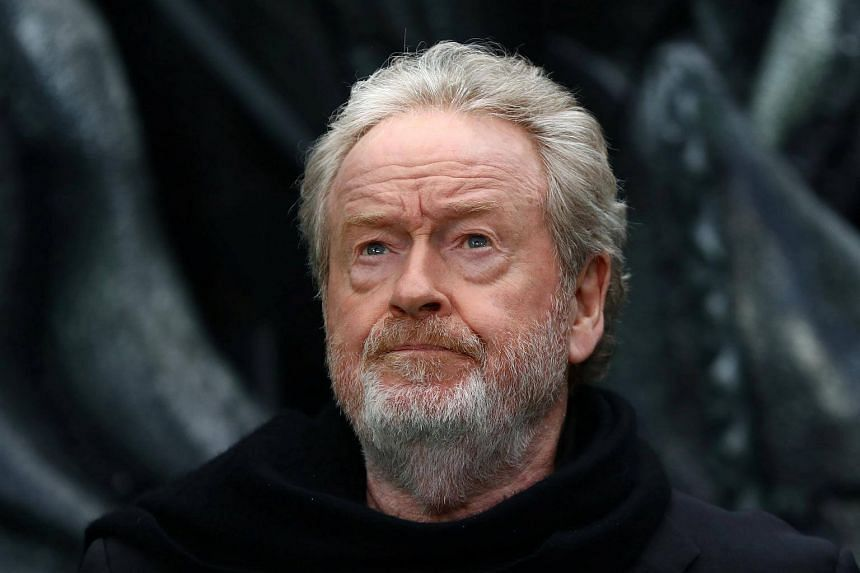 Director Ridley Scott poses for photographers at the World Premiere of Alien: Covenant in London.