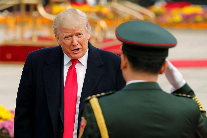 US President Donald Trump takes part in a welcoming ceremony in Beijing.