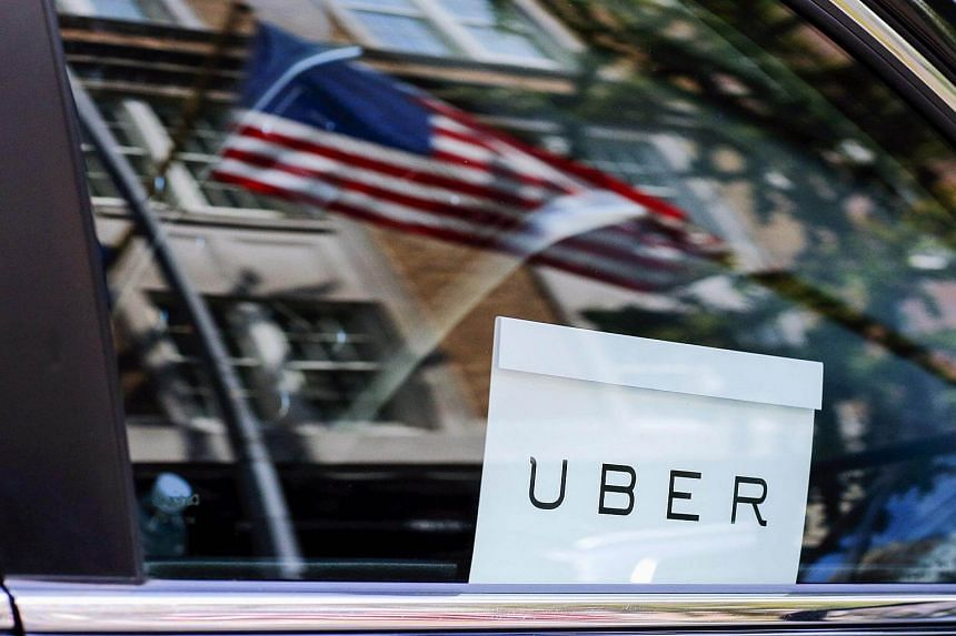 An Uber sign is seen in a car in New York.