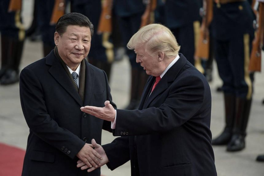 China's President Xi Jinping (left) and US President Donald Trump attend a welcome ceremony at the Great Hall of the People in Beijing.