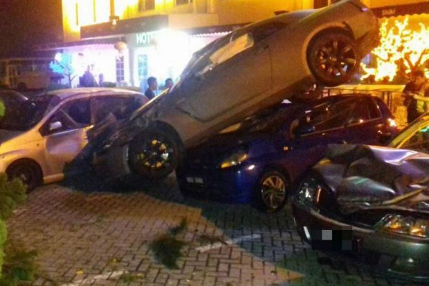 A Singaporean driver who was speeding past a road bump lost control and rammed his car into four cars parked in front of a budget hotel in Johor Baru.