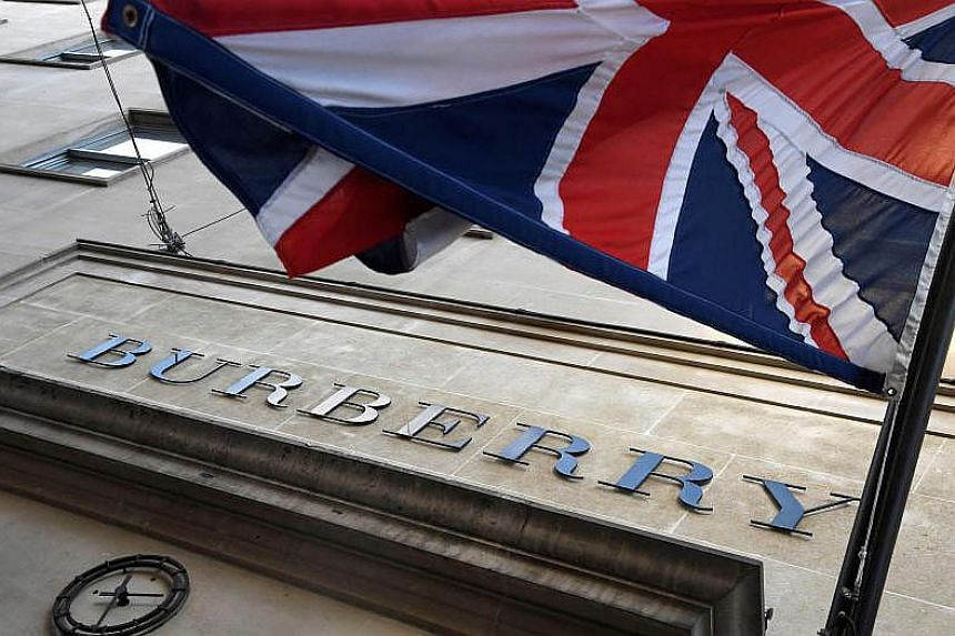 Burberry Group's shares fell as much as 14 per cent after CEO Marco Gobbetti said it will expand its lineup of accessories and leather goods and revamp its marketing while investing in store refurbishments.