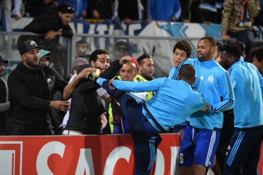 Patrice Evra faces a lengthy UEFA ban for kicking a fan.