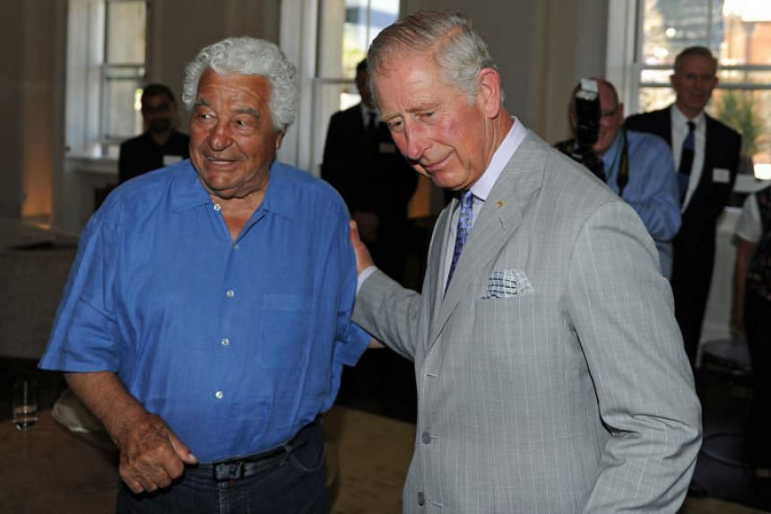 Britain's Prince Charles (right) greeting renowned local chef Antonio Carluccio as he tours the restored historical State Buildings in Perth on Nov 15, 2015.