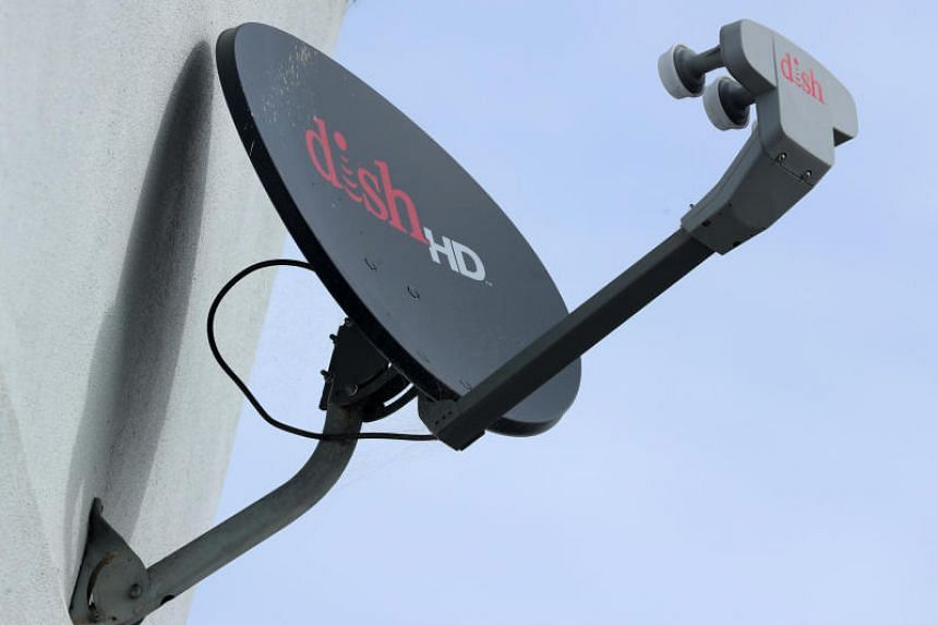 A Dish Network satellite dish is shown on a residential home in Encinitas, California, US on Nov 8, 2017.
