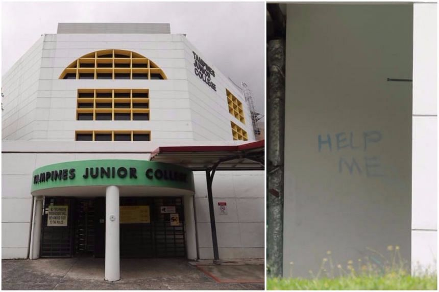 """The """"Help me"""" message was written in capital letters on a wall near the school's canteen."""