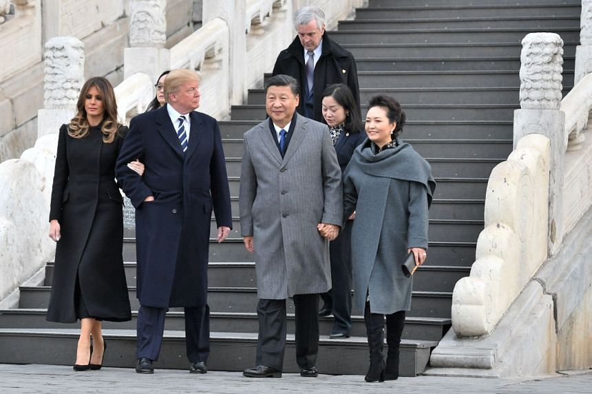 US President Donald Trump tours the Forbidden City in Beijing with First Lady Melania Trump, China's President Xi Jinping and his wife Peng Liyuan.
