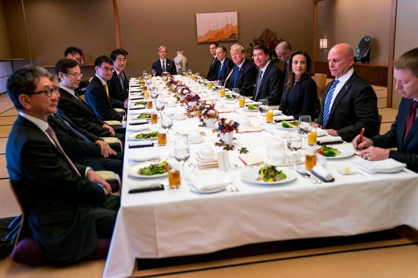 US President Donald Trump (5th right) and Japan's Prime Minister Shinzo Abe (5th left) attend a working lunch at the Akasaka Palace in Tokyo on Nov 6, 2017.