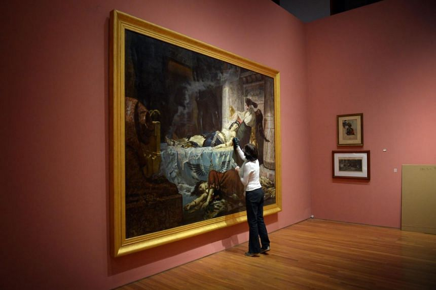 A behind-the-scenes shot of Cleopatra by Juan Luna from the Between Worlds: Raden Saleh and Juan Luna exhibition at the National Gallery Singapore.