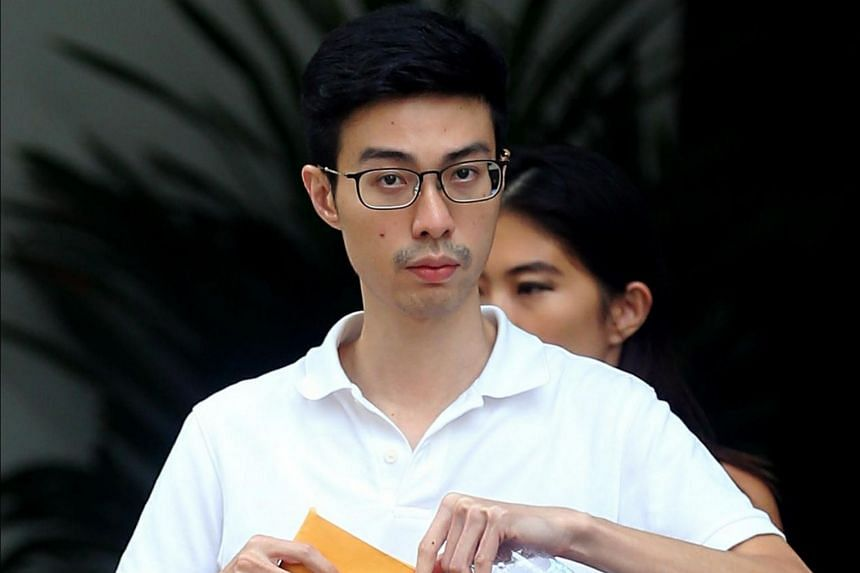 Former bank officer Paul Liew Ziguang, 30, was charged in court with 13 counts of forgery for the purpose of cheating involving housing loans of $7.7 million.