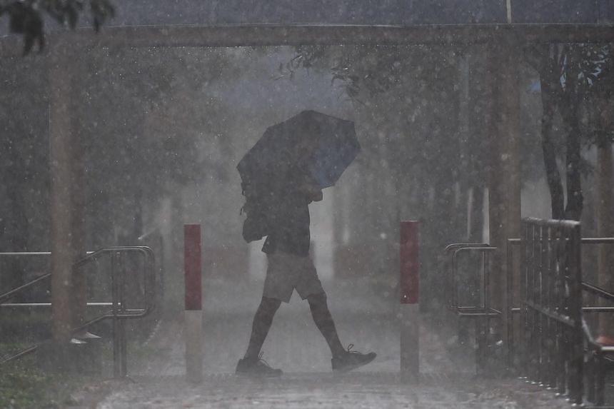"""The National Environment Agency issued a heavy rain warning at 3.50pm, forecasting """"moderate to heavy thundery showers with gusty winds"""" that are expected to continue over many areas in Singapore."""